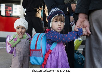 Munich, Germany - September 10th, 2015: Refugees children from Afghanistan countries hopping on the next train at the main station in Munich.