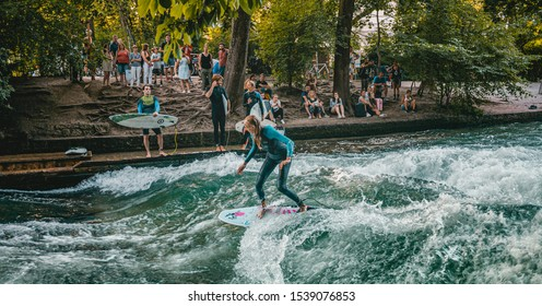 Munich, Germany – SEPTEMBER, 19 2019: : surfer works the wave at the eisbachwell standing wave SEPTEMBER 19, 2019 in Munich.
