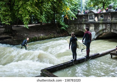 MUNICH, GERMANY - SEPTEMBER 20: Surfer on the Eisbach in the English Garden in Munich on September 20, 2013 in Munich, Germany