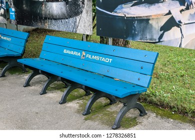 Munich, Germany - September, 2018: Bavaria Filmstadt blue bench outside  this tourist attraction. Visitors can see sets and props from The Neverending Story, Das Boot, Marienhof, Asterix and Obelix.