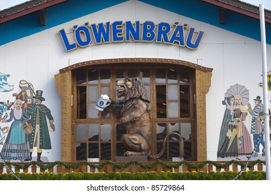 """MUNICH, GERMANY - SEPTEMBER 21: lion over entrance of brewery Loewenbraeu beer hall  at world biggest beer festival """"Oktoberfest in Munich"""" on September  21, 2011 in Munich, Germany"""