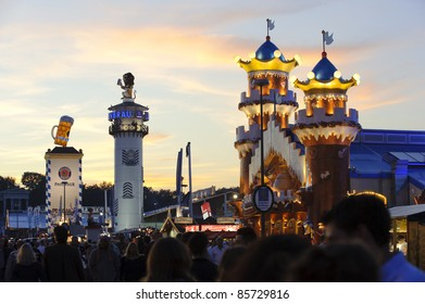 """MUNICH, GERMANY - SEPTEMBER 21: panorama view at evening to the tents of bavarian beer breweries  of world biggest beer festival """"Oktoberfest in Munich"""" on September  21, 2011 in Munich, Germany"""