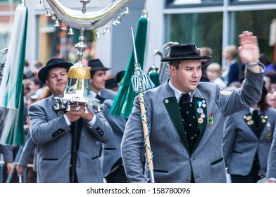 MUNICH, GERMANY - SEPTEMBER 21: Parade of the hosts of the tents of the Oktoberfest on September 21, 2013 in Munich, Germany