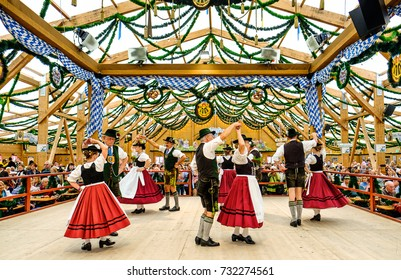 "MUNICH, GERMANY - SEPTEMBER 21: people in the ""traditon""-beer tent at the biggest folk festival in the world - the octoberfest on september 21, 2017 in munich."