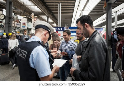 Munich, Germany -September 22, 2015: Refugees arriving at the trainstation in Munich. The asylum seekers from Syria, Afghanistan and other insecure countries are happy to arrive in Germany.
