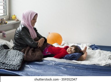 Munich - Germany - September 22, 2015 Mother and small daughter from Afghanistan in the initial reception center for refugees in Riem, Munich