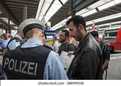 Munich, Germany - September 22, 2015: Refugees arriving at the trainstation in Munich. The asylum seekers from Syria, Afghanistan and other insecure countries are happy to arrive in Germany.