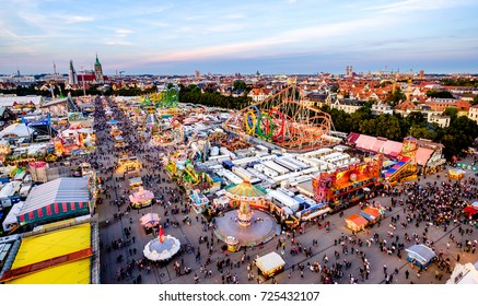 MUNICH, GERMANY - SEPTEMBER 22: people and fairground rides at the biggest folk festival in the world - the octoberfest on september 22, 2016 in munich.