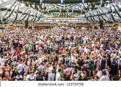 MUNICH, GERMANY - SEPTEMBER 23, 2012: Oktoberfest, Munich: Overview over the big beer tent. In the background is the band.