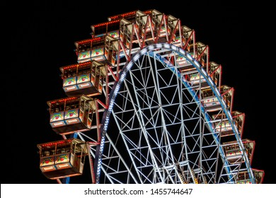 Munich, Germany - September 26, 2015: Ferris wheel on the fairground of the Octoberfest in Munich at night