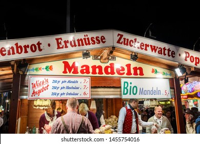 Munich, Germany - September 26, 2015: Sales stall for takeaway food (peanuts, roasted almonds, candyfloss, popcorn) at Oktoberfest