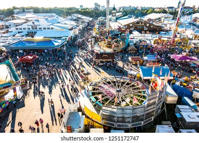 Munich, Germany - September 27: people and fairground rides at the biggest folk festival in the world - the oktoberfest on september 27, 2018 in munich.