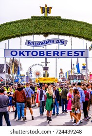 MUNICH, GERMANY - SEPTEMBER 28: people and fairground rides at the biggest folk festival in the world - the octoberfest on september 28, 2017 in munich.