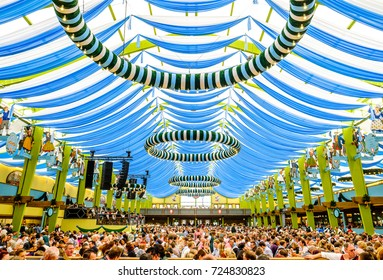 "MUNICH, GERMANY - SEPTEMBER 28: people in the ""Spaten""-beer tent at the biggest folk festival in the world - the octoberfest on september 28, 2017 in munich."
