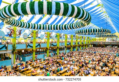 """MUNICH, GERMANY - SEPTEMBER 28: people in the """"Spaten""""-beer tent at the biggest folk festival in the world - the octoberfest on september 28, 2017 in munich."""