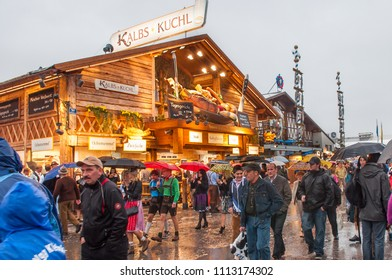 MUNICH, GERMANY - SEPTEMBER 29, 2012: Tourists at October fest ,is the world's largest  Volksfest, beer festival and travelling funfair.