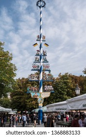 Munich, Germany - September 29, 2017: The traditional maypole at the famous Viktualienmarkt (vegetable market) of Munich, Germany