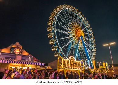 Munich, Germany - September 30: people and fairground rides at the biggest folk festival in the world - the oktoberfest on september 30, 2018 in munich.