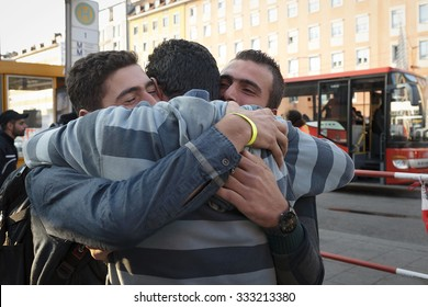 Munich, Germany - September 8th, 2015: An uncle and nephew from Syria are both moved to tears when meeting at the Munich central station.They didn't see each other for years.
