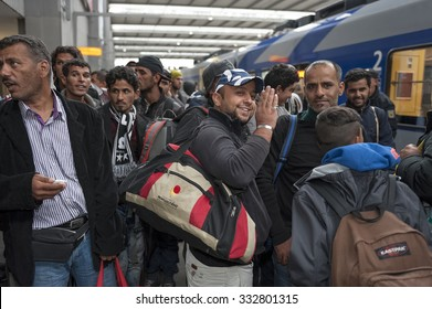 Munich, Germany - September 9, 2015: Refugees arriving at the trainstation in Munich. The asylum seekers from Syria, Afghanistan and other insecure countries are happy to arrive in Germany.