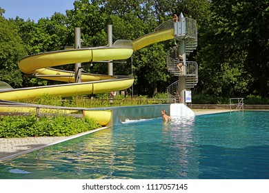 MUNICH, GERMAY -JUNE 11, 2018  curved slide and trees, natural environment for leisure and fun at Ungarerbad,  swimming bath in Munich