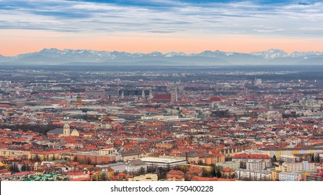 Munich historical center panoramic aerial cityscape view with Alps mountains ridge on skyline before sunset