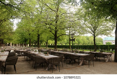 Munich - Hofgarten green park in city center early in the morning, with the beer garden tables ready for customers