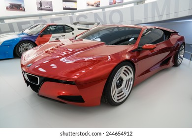 MUNICH - JANUARY 05: Modern futuristic red BMW on stand display in BMW Museum on January 05, 2015 in Munich, Bavaria, Germany.