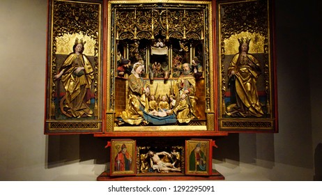 MUNICH - JUL 22, 2018 - Carved nativity scene altar triptych, Bavarian National Museum, Munich, Germany