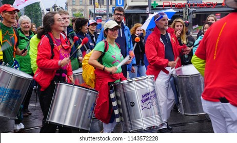 "MUNICH - JUL 22, 2018 - Drummers march to protest the Bavarian Social Union (CSU) "" Together against the politics of fear"" in centralMunich, Germany"