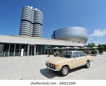 MUNICH - JUNE 8: BMW classic car parked in front of BMW Museum and headquarters on June 8, 2013 in Munich