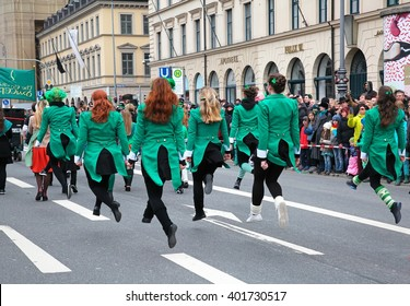 MUNICH - MARCH 13: irish dancers march at St. Patrick's day on March 13, 2016 in Munich, Germany. This national Irish holiday takes place annually in March in Dublin and other European cities.