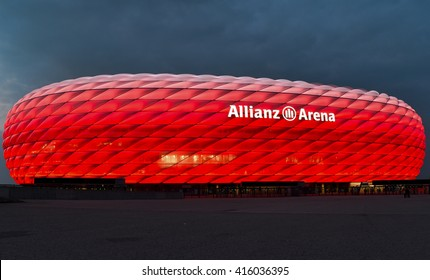MUNICH - MARCH 27: Allianz Arena football stadium illuminated in red and white in Munich, Germany. It is the home of stadium the FC Bayern Munich and TSV 1860 Munchen