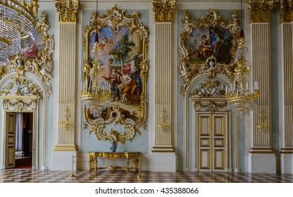 MUNICH (MUNCHEN), GERMANY - 03 MAY 2016: Gold luxury interior of Ceremonial hall (Festsaal) in Nymphenburg castle (Schloss). A cycle of frescos framed by lavish rococo stucco-work - style of Bavaria