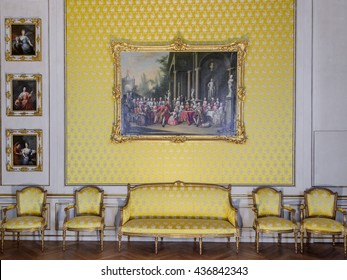 MUNICH (MUNCHEN), GERMANY - 03 MAY 2016: Gold luxury interior of Bedchamber in Nymphenburg Schloss. This room served as a guest apartment. The painting shows the electoral Bavarian and Saxon family.