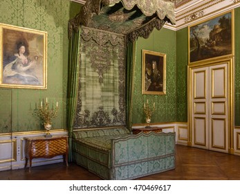 MUNICH (MUNCHEN), GERMANY - 03 MAY 2016: Gold luxury interior of Bedchamber in Nymphenburg Schloss. The electress slept on the imperial bed beneath a ceiling picture of the flower goddess Flora.