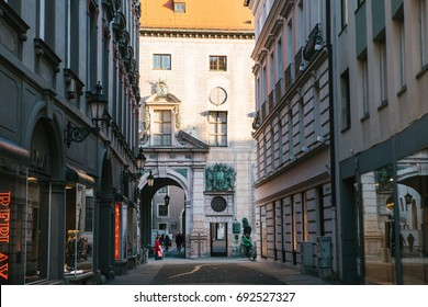 Munich, October 29, 2017: Perspective view of alley, narrow street intersection surrounded by modern and historical buildings
