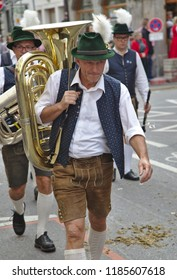 """MUNICH - September 22, 2018: It's the beginning of the """"Oktoberfest"""". Before the official start, the traditional breweries, who sell on the """"Wies'n"""", parade onto the Theresienwiese."""