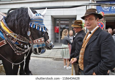 """MUNICH - September 22, 2018: It's the beginning of the """"Oktoberfest"""". Before the official start, the traditional breweries, who sell on the """"Wiesn"""", parade onto the Theresienwiese."""