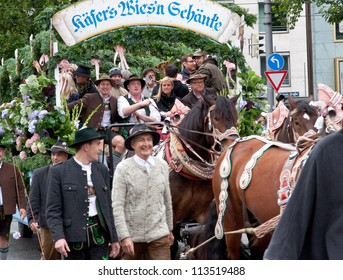 MUNICH - SEPTEMBER 22: horse carriage takes part into Oktoberfest solemn procession September 22, 2012 in Munich, Bavaria, Germany. Oktoberfest is annually beer festival.