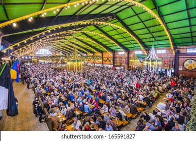 MUNICH - SEPTEMBER 30: Beer Tent on the Theresienwiese Oktoberfest fair grounds September 30, 2013 in Munich, Germany.