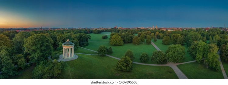 Munich skyline, view from Monopteros temple in Englischer Garten, Germany. The image shows: Bavarian State Chancellery, Tower of St. Peter Church, Tower of New Town Hall, Frauenkirche, Theatinerkirche