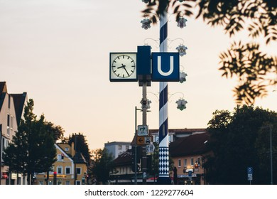 Munich U-Bahn station sign with stylish clock and vintage effect