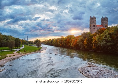 Munich view - Isar river, park and St Maximilian church from Reichenbach Bridge on sunset. Munchen, Bavaria, Germany.
