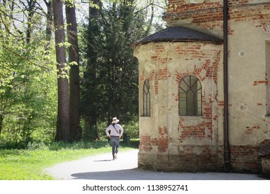 Munich, view of Nymphenburg park and a turret of  Magdalenenklause or Magdalene Hermitage, built in XVII century like a hermit living quarter and church