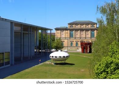 Munich/Germany- 2019: Flying Saucer (Futuro) in front of the Pinakothek der Modern Museum in Munich