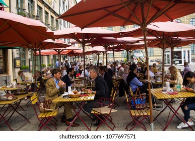 Munich,Germany-April 26,2018: Locals and tourists enjoy lunch on a terrace on a sunny day at noon