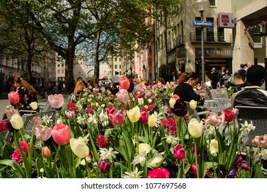 Munich,Germany-April 26,2018: People enjoy the warm temperatures while shopping in downtown Munich