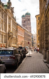 Munich,Germany-August 07,2017: View of  the towers of the Liebrauendom in Munich from a sidestreet