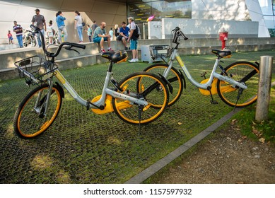 Munich,Germany-August 15,2018:Two rental bikes from the company Obike stand outside a building